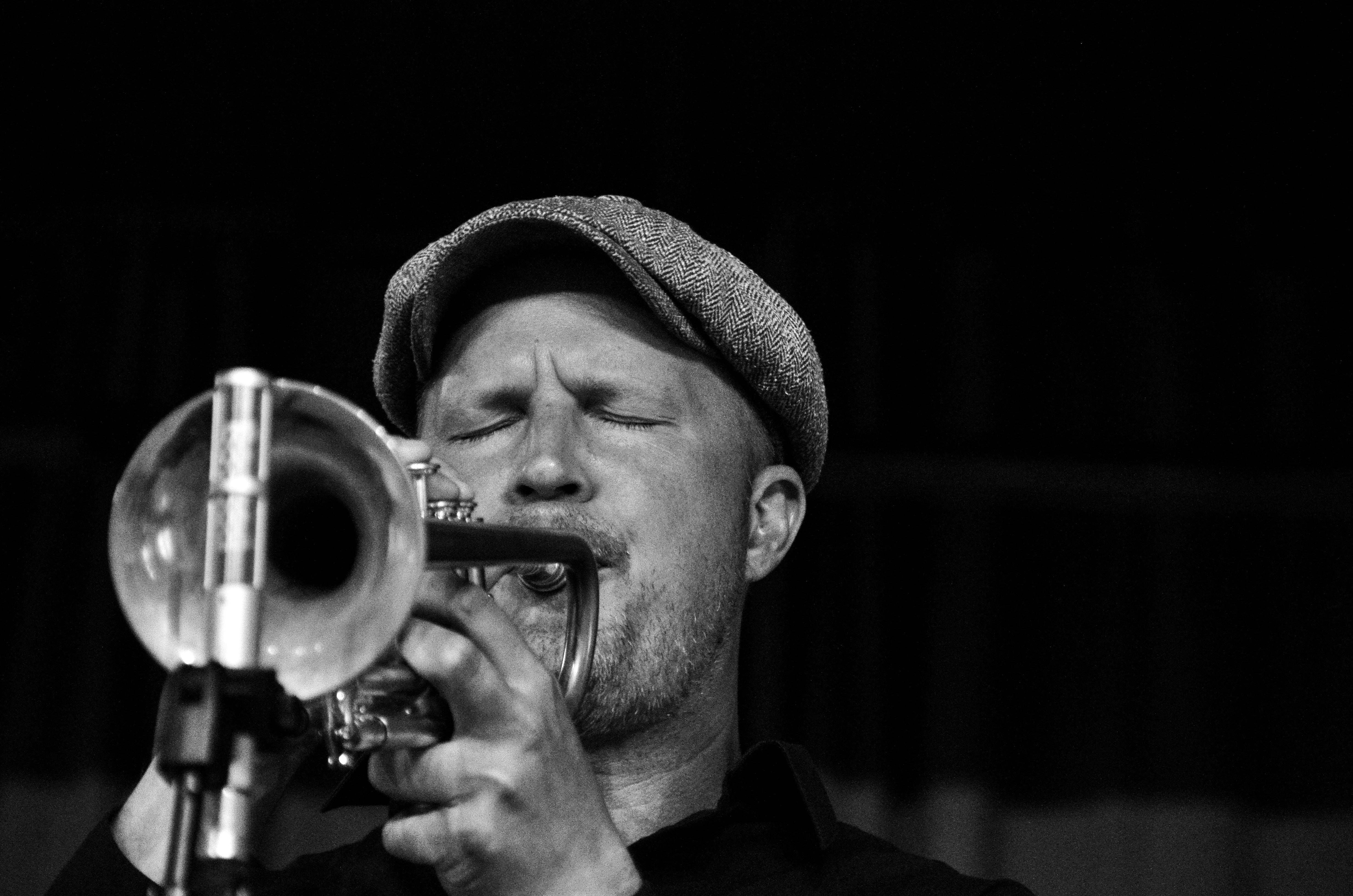 grayscale photo of musician